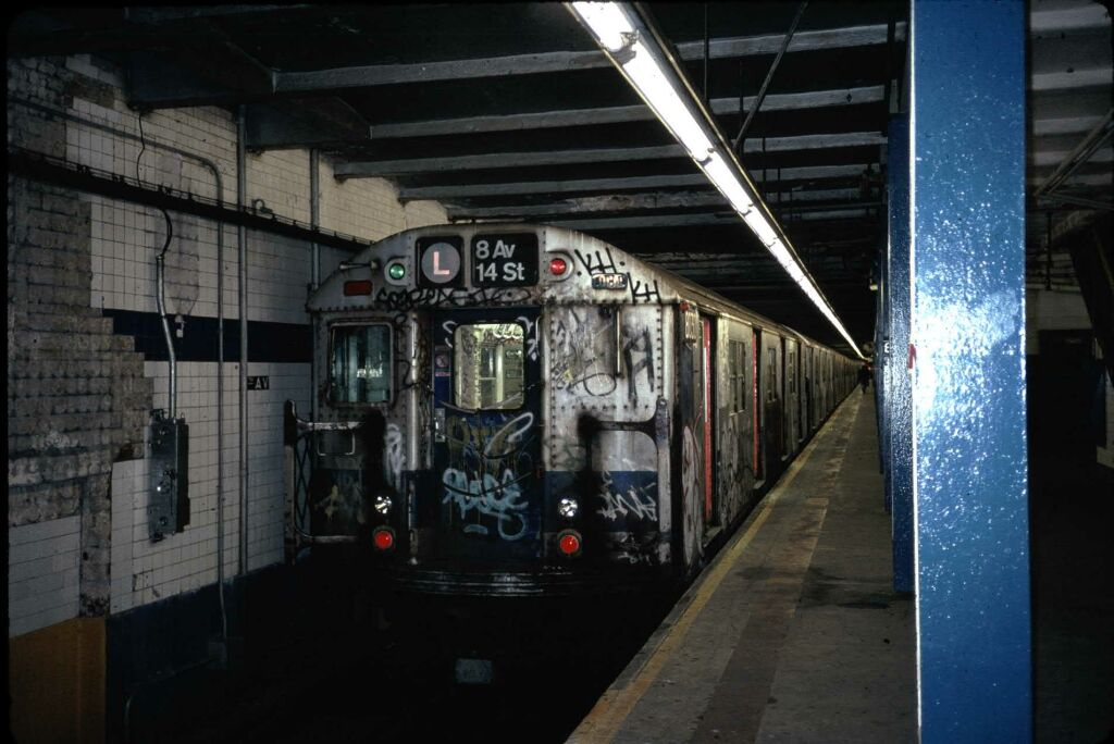 (107k, 1024x684)<br><b>Country:</b> United States<br><b>City:</b> New York<br><b>System:</b> New York City Transit<br><b>Line:</b> BMT Canarsie Line<br><b>Location:</b> 8th Avenue <br><b>Route:</b> L<br><b>Car:</b> R-27 (St. Louis, 1960)  8030 <br><b>Photo by:</b> Glenn L. Rowe<br><b>Date:</b> 9/29/1988<br><b>Viewed (this week/total):</b> 4 / 8844