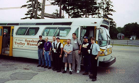 (51k, 569x341)<br><b>Country:</b> United States<br><b>City:</b> Kennebunk, ME<br><b>System:</b> Seashore Trolley Museum <br><b>Photo by:</b> Thurston Clark<br><b>Date:</b> 7/15/2000<br><b>Notes:</b> Group shot of field trippers and staff in front of MBTA #6129 GM Fishbowl. L to R: David Cole; Todd Glickman; Tim Speer; Jeremy Whiteman; Bill Steil; Lou from Brooklyn; Doug the BMT Man; Phil Domingnez<br><b>Viewed (this week/total):</b> 0 / 3850