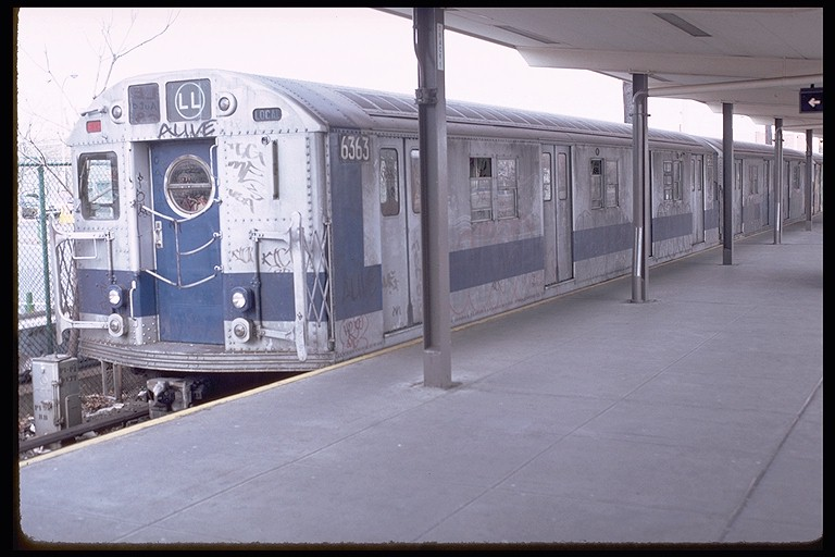 (101k, 768x512)<br><b>Country:</b> United States<br><b>City:</b> New York<br><b>System:</b> New York City Transit<br><b>Line:</b> BMT Canarsie Line<br><b>Location:</b> Rockaway Parkway <br><b>Route:</b> LL<br><b>Car:</b> R-16 (American Car & Foundry, 1955) 6363 <br><b>Photo by:</b> Doug Grotjahn<br><b>Collection of:</b> Joe Testagrose<br><b>Date:</b> 11/22/1980<br><b>Viewed (this week/total):</b> 1 / 3438