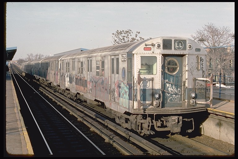 (130k, 768x512)<br><b>Country:</b> United States<br><b>City:</b> New York<br><b>System:</b> New York City Transit<br><b>Line:</b> BMT Canarsie Line<br><b>Location:</b> New Lots Avenue <br><b>Route:</b> LL<br><b>Car:</b> R-16 (American Car & Foundry, 1955) 6375 <br><b>Photo by:</b> Ed McKernan<br><b>Collection of:</b> Joe Testagrose<br><b>Date:</b> 12/22/1976<br><b>Viewed (this week/total):</b> 3 / 3253