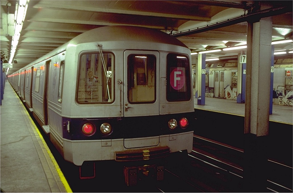 (174k, 1024x674)<br><b>Country:</b> United States<br><b>City:</b> New York<br><b>System:</b> New York City Transit<br><b>Line:</b> IND Queens Boulevard Line<br><b>Location:</b> 179th Street <br><b>Route:</b> F<br><b>Car:</b> R-46 (Pullman-Standard, 1974-75) 604 <br><b>Photo by:</b> Doug Grotjahn<br><b>Collection of:</b> Joe Testagrose<br><b>Date:</b> 8/12/1980<br><b>Viewed (this week/total):</b> 11 / 8559
