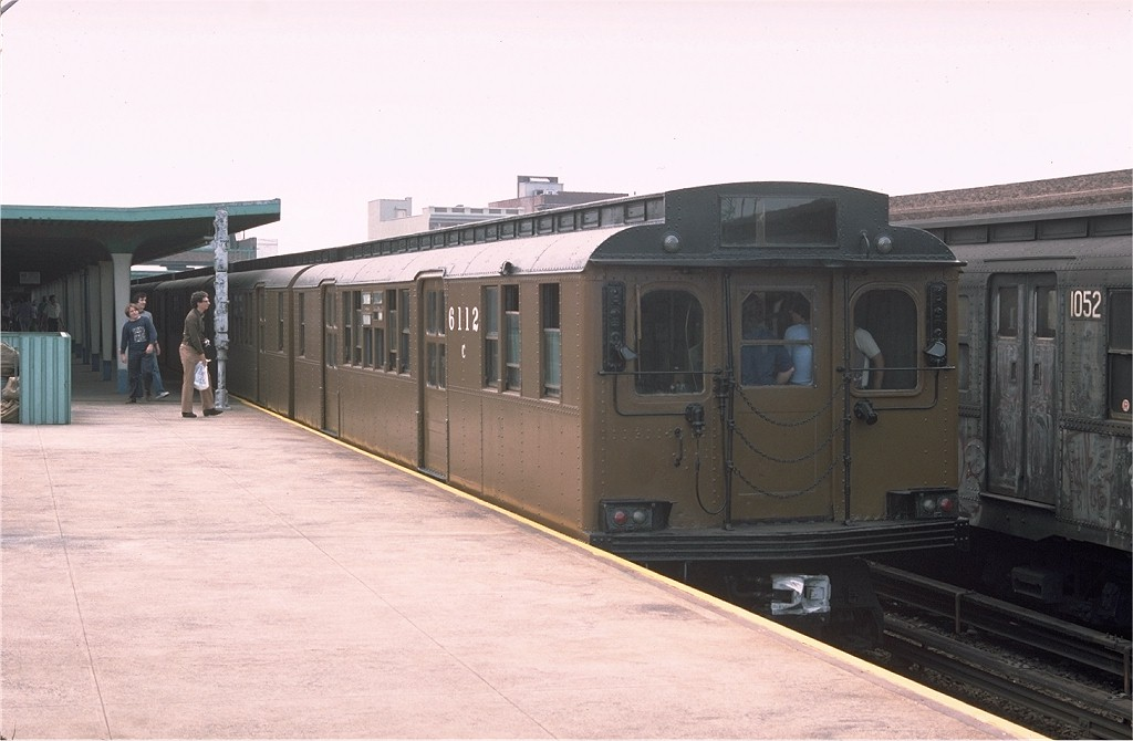(139k, 1024x670)<br><b>Country:</b> United States<br><b>City:</b> New York<br><b>System:</b> New York City Transit<br><b>Line:</b> IND Rockaway<br><b>Location:</b> Rockaway Park/Beach 116th Street <br><b>Route:</b> Fan Trip<br><b>Car:</b> BMT D-Type Triplex 6112 <br><b>Photo by:</b> Doug Grotjahn<br><b>Collection of:</b> Joe Testagrose<br><b>Date:</b> 7/31/1976<br><b>Viewed (this week/total):</b> 1 / 2473