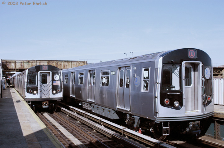 (127k, 720x478)<br><b>Country:</b> United States<br><b>City:</b> New York<br><b>System:</b> New York City Transit<br><b>Line:</b> BMT Canarsie Line<br><b>Location:</b> Livonia Avenue <br><b>Route:</b> L<br><b>Car:</b> R-143 (Kawasaki, 2001-2002) 8108&8301 <br><b>Photo by:</b> Peter Ehrlich<br><b>Date:</b> 3/4/2003<br><b>Notes:</b> This is a meeting of the first production train and the most recently-delivered train, which was undergoing acceptance testing.<br><b>Viewed (this week/total):</b> 3 / 17780