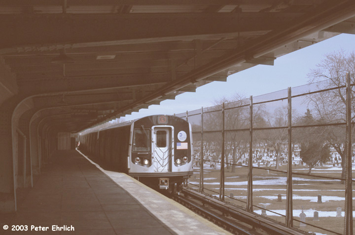 (110k, 720x478)<br><b>Country:</b> United States<br><b>City:</b> New York<br><b>System:</b> New York City Transit<br><b>Line:</b> BMT Canarsie Line<br><b>Location:</b> Wilson Avenue <br><b>Route:</b> L<br><b>Car:</b> R-143 (Kawasaki, 2001-2002) 8141 <br><b>Photo by:</b> Peter Ehrlich<br><b>Date:</b> 3/4/2003<br><b>Viewed (this week/total):</b> 4 / 5532