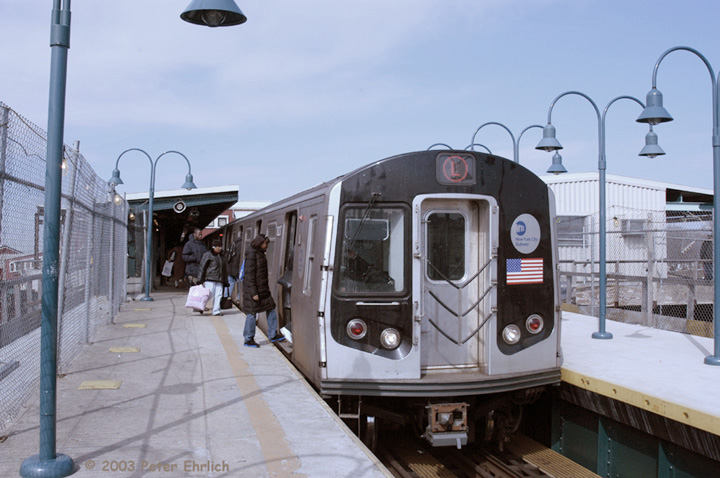 (126k, 720x478)<br><b>Country:</b> United States<br><b>City:</b> New York<br><b>System:</b> New York City Transit<br><b>Line:</b> BMT Canarsie Line<br><b>Location:</b> Broadway Junction <br><b>Route:</b> L<br><b>Car:</b> R-143 (Kawasaki, 2001-2002) 8237 <br><b>Photo by:</b> Peter Ehrlich<br><b>Date:</b> 3/4/2003<br><b>Viewed (this week/total):</b> 2 / 4050