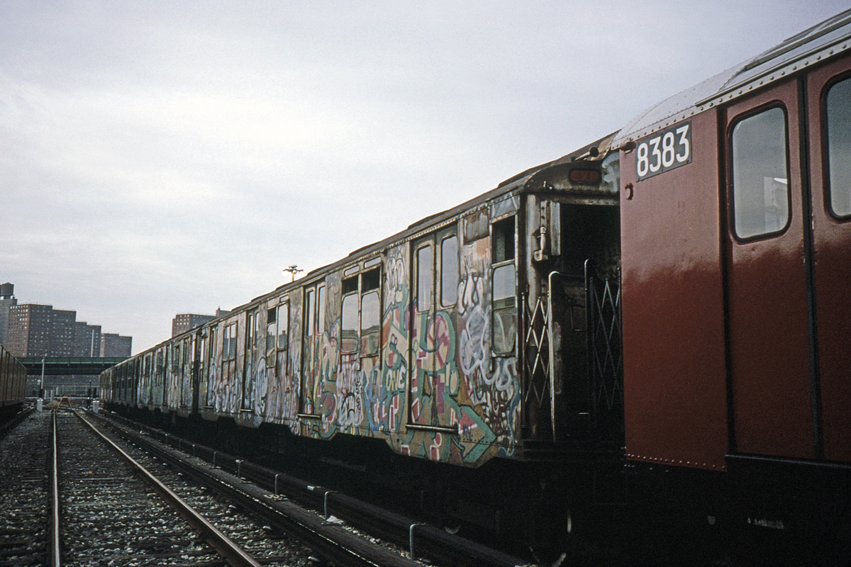 (408k, 1044x708)<br><b>Country:</b> United States<br><b>City:</b> New York<br><b>System:</b> New York City Transit<br><b>Location:</b> Coney Island Yard<br><b>Car:</b> R-10 (American Car & Foundry, 1948) 3309 <br><b>Photo by:</b> Glenn L. Rowe<br><b>Collection of:</b> David Pirmann<br><b>Date:</b> 4/10/1990<br><b>Notes:</b> With R30 8383<br><b>Viewed (this week/total):</b> 5 / 4553