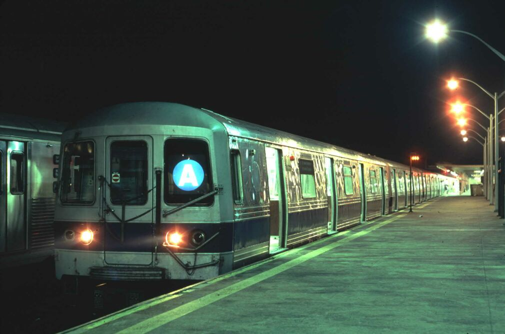 (81k, 1010x668)<br><b>Country:</b> United States<br><b>City:</b> New York<br><b>System:</b> New York City Transit<br><b>Line:</b> IND Rockaway<br><b>Location:</b> Rockaway Park/Beach 116th Street <br><b>Car:</b> R-44 (St. Louis, 1971-73) 310 <br><b>Photo by:</b> Glenn L. Rowe<br><b>Date:</b> 8/17/1991<br><b>Viewed (this week/total):</b> 2 / 6340
