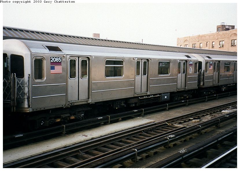 (101k, 830x591)<br><b>Country:</b> United States<br><b>City:</b> New York<br><b>System:</b> New York City Transit<br><b>Line:</b> IRT Flushing Line<br><b>Location:</b> 52nd Street/Lincoln Avenue <br><b>Route:</b> 7<br><b>Car:</b> R-62A (Bombardier, 1984-1987)  2085 <br><b>Photo by:</b> Gary Chatterton<br><b>Date:</b> 4/3/2003<br><b>Viewed (this week/total):</b> 3 / 2055