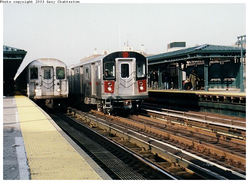 (113k, 810x596)<br><b>Country:</b> United States<br><b>City:</b> New York<br><b>System:</b> New York City Transit<br><b>Line:</b> IRT Woodlawn Line<br><b>Location:</b> 161st Street/River Avenue (Yankee Stadium) <br><b>Route:</b> 4<br><b>Car:</b> R-62 (Kawasaki, 1983-1985)  1566 <br><b>Photo by:</b> Gary Chatterton<br><b>Date:</b> 4/2/2003<br><b>Notes:</b> With R142 7176<br><b>Viewed (this week/total):</b> 1 / 6492