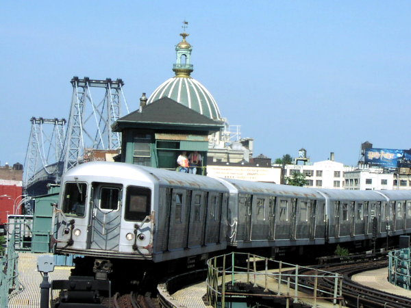 (72k, 600x450)<br><b>Country:</b> United States<br><b>City:</b> New York<br><b>System:</b> New York City Transit<br><b>Line:</b> BMT Nassau Street/Jamaica Line<br><b>Location:</b> Marcy Avenue <br><b>Route:</b> J<br><b>Car:</b> R-42 (St. Louis, 1969-1970)  4877 <br><b>Photo by:</b> Trevor Logan<br><b>Date:</b> 8/29/2001<br><b>Viewed (this week/total):</b> 6 / 3353
