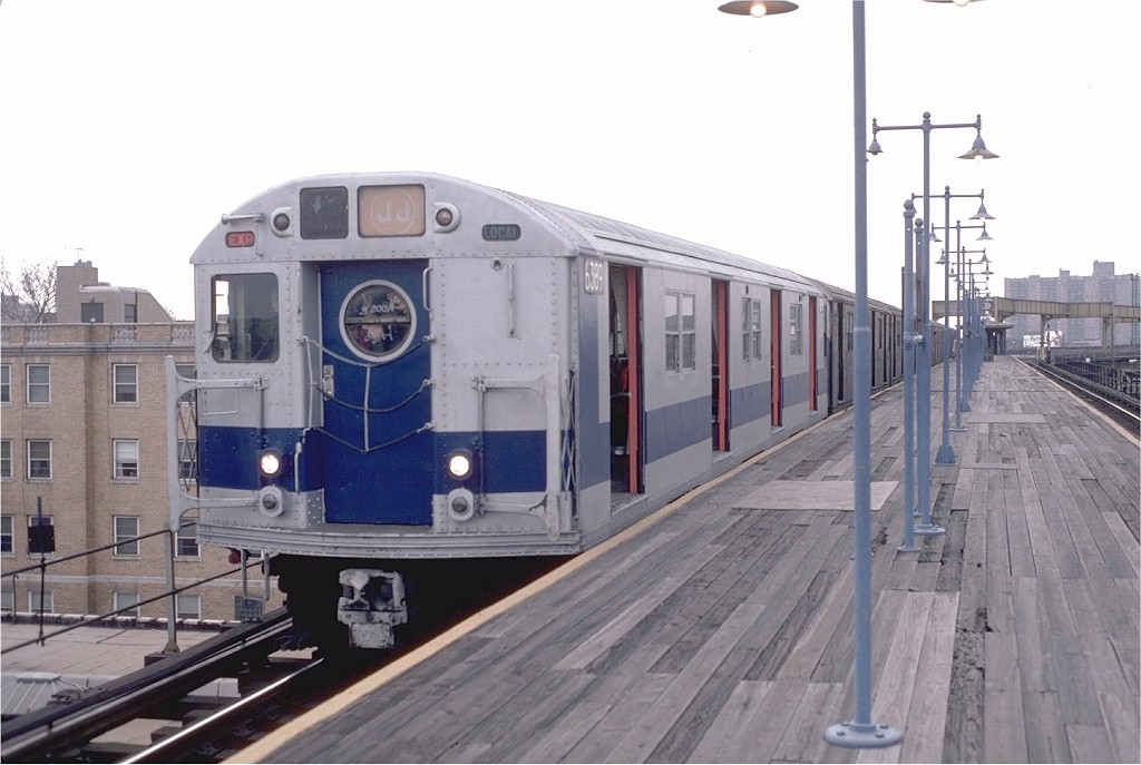 (151k, 1024x687)<br><b>Country:</b> United States<br><b>City:</b> New York<br><b>System:</b> New York City Transit<br><b>Line:</b> BMT Nassau Street/Jamaica Line<br><b>Location:</b> Alabama Avenue <br><b>Route:</b> J<br><b>Car:</b> R-16 (American Car & Foundry, 1955) 6389 <br><b>Photo by:</b> Doug Grotjahn<br><b>Collection of:</b> Joe Testagrose<br><b>Date:</b> 1/30/1983<br><b>Notes:</b> (There was some discussion about the date of this photo-- that it was from the late 60s-- but the blue & silver exterior and tan & orange interiors didn't appear together till the late 70s.)<br><b>Viewed (this week/total):</b> 8 / 5469