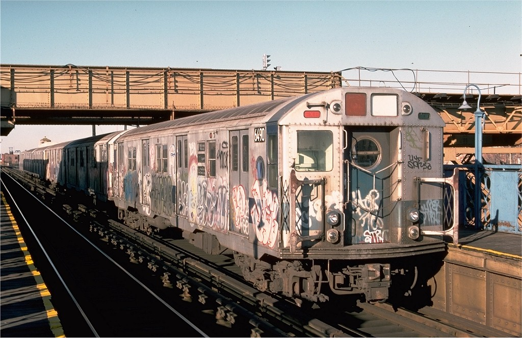 (218k, 1024x663)<br><b>Country:</b> United States<br><b>City:</b> New York<br><b>System:</b> New York City Transit<br><b>Line:</b> BMT Canarsie Line<br><b>Location:</b> Livonia Avenue <br><b>Route:</b> LL<br><b>Car:</b> R-16 (American Car & Foundry, 1955) 6490 <br><b>Photo by:</b> Ed McKernan<br><b>Collection of:</b> Joe Testagrose<br><b>Date:</b> 12/24/1976<br><b>Viewed (this week/total):</b> 0 / 5667