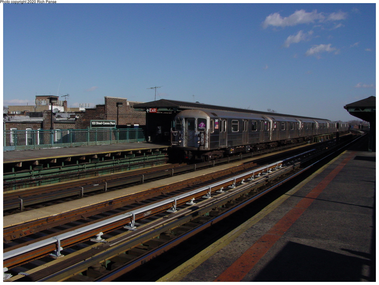 (71k, 820x620)<br><b>Country:</b> United States<br><b>City:</b> New York<br><b>System:</b> New York City Transit<br><b>Line:</b> IRT Flushing Line<br><b>Location:</b> 103rd Street/Corona Plaza <br><b>Route:</b> 7<br><b>Car:</b> R-62A (Bombardier, 1984-1987)  2087 <br><b>Photo by:</b> Richard Panse<br><b>Date:</b> 1/20/2003<br><b>Viewed (this week/total):</b> 1 / 2999