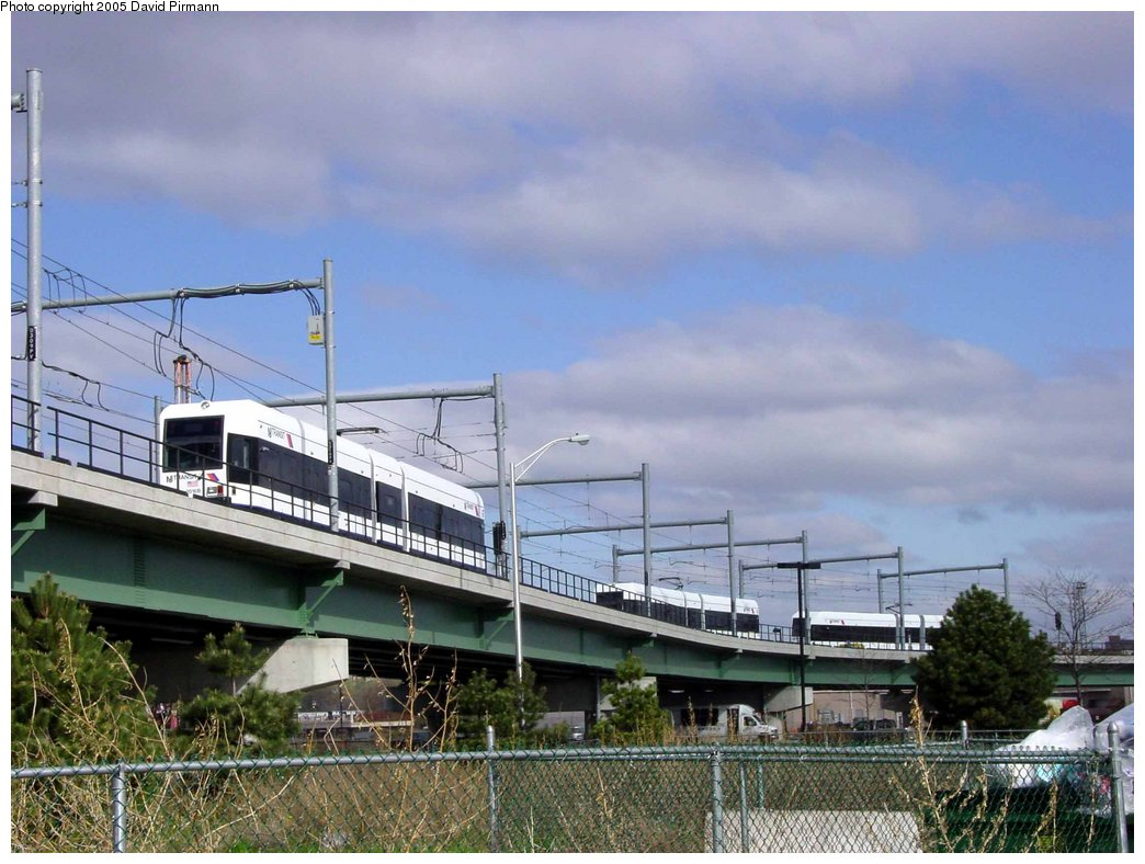 (168k, 1044x788)<br><b>Country:</b> United States<br><b>City:</b> Jersey City, NJ<br><b>System:</b> Hudson Bergen Light Rail<br><b>Location:</b> Between Newport & Hoboken <br><b>Photo by:</b> David Pirmann<br><b>Date:</b> 4/24/2003<br><b>Notes:</b> Three-way meet of HBLR cars: one northbound, one in pocket track, one southbound<br><b>Viewed (this week/total):</b> 2 / 3331