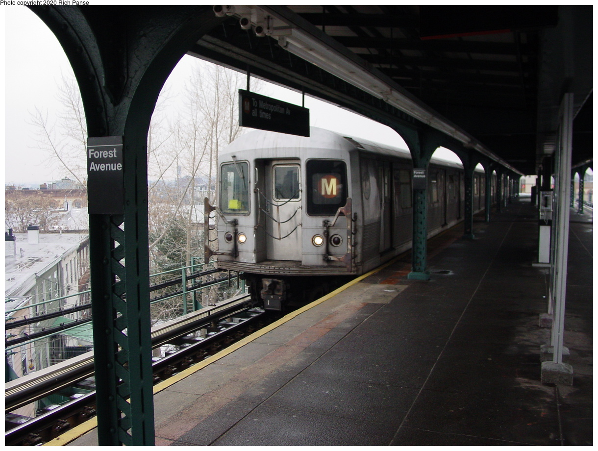 (78k, 820x620)<br><b>Country:</b> United States<br><b>City:</b> New York<br><b>System:</b> New York City Transit<br><b>Line:</b> BMT Myrtle Avenue Line<br><b>Location:</b> Forest Avenue <br><b>Route:</b> M<br><b>Car:</b> R-42 (St. Louis, 1969-1970)   <br><b>Photo by:</b> Richard Panse<br><b>Date:</b> 1/29/2003<br><b>Viewed (this week/total):</b> 2 / 4316
