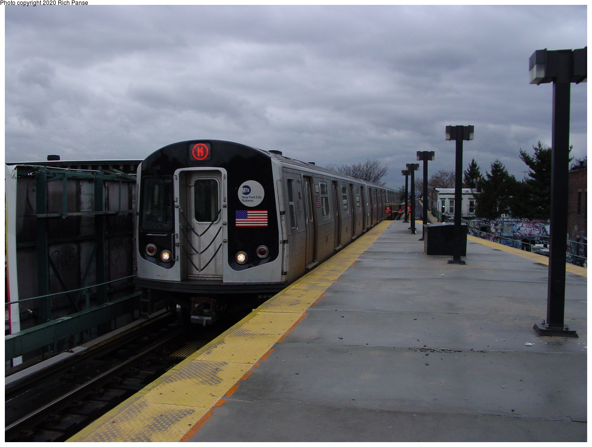 (57k, 820x620)<br><b>Country:</b> United States<br><b>City:</b> New York<br><b>System:</b> New York City Transit<br><b>Line:</b> BMT Myrtle Avenue Line<br><b>Location:</b> Fresh Pond Road <br><b>Route:</b> M<br><b>Car:</b> R-143 (Kawasaki, 2001-2002)  <br><b>Photo by:</b> Richard Panse<br><b>Date:</b> 2/23/2003<br><b>Viewed (this week/total):</b> 3 / 5923