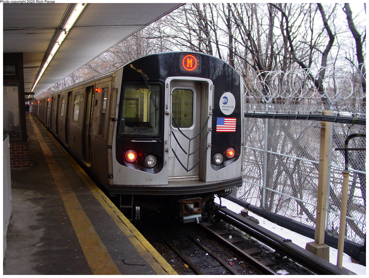 (116k, 820x620)<br><b>Country:</b> United States<br><b>City:</b> New York<br><b>System:</b> New York City Transit<br><b>Line:</b> BMT Myrtle Avenue Line<br><b>Location:</b> Metropolitan Avenue <br><b>Route:</b> M<br><b>Car:</b> R-143 (Kawasaki, 2001-2002) 8136 <br><b>Photo by:</b> Richard Panse<br><b>Date:</b> 2/23/2003<br><b>Viewed (this week/total):</b> 0 / 6894
