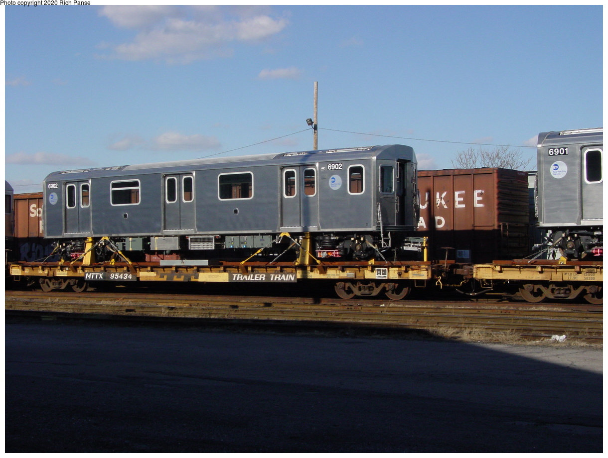 (61k, 820x620)<br><b>Country:</b> United States<br><b>City:</b> New York<br><b>System:</b> New York City Transit<br><b>Location:</b> LIRR/NY & Atlantic RR Fresh Pond Yard <br><b>Car:</b> R-142 (Primary Order, Bombardier, 1999-2002)  6902 <br><b>Photo by:</b> Richard Panse<br><b>Date:</b> 1/21/2003<br><b>Viewed (this week/total):</b> 6 / 5236