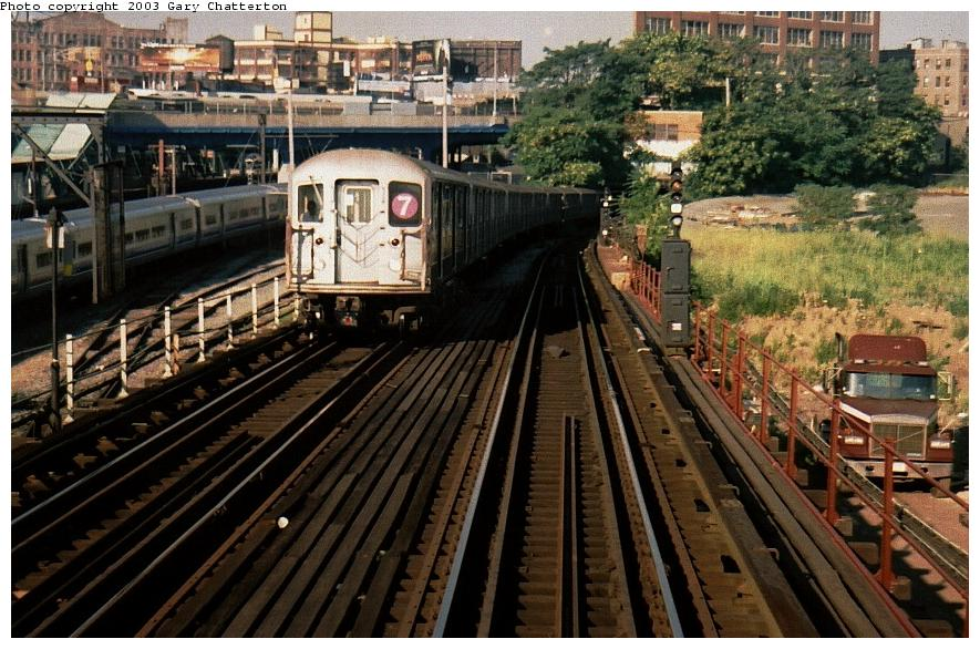 (113k, 885x586)<br><b>Country:</b> United States<br><b>City:</b> New York<br><b>System:</b> New York City Transit<br><b>Line:</b> IRT Flushing Line<br><b>Location:</b> Viaduct approach east of Hunterspoint Ave. <br><b>Route:</b> 7<br><b>Car:</b> R-62A (Bombardier, 1984-1987)  2153 <br><b>Photo by:</b> Gary Chatterton<br><b>Date:</b> 8/2002<br><b>Viewed (this week/total):</b> 4 / 5451