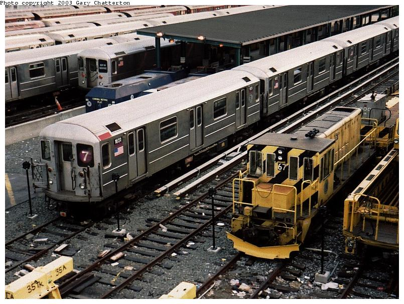 (122k, 805x606)<br><b>Country:</b> United States<br><b>City:</b> New York<br><b>System:</b> New York City Transit<br><b>Location:</b> Corona Yard<br><b>Car:</b> R-62A (Bombardier, 1984-1987)  1651 <br><b>Photo by:</b> Gary Chatterton<br><b>Date:</b> 5/24/2003<br><b>Notes:</b> With Loco 67<br><b>Viewed (this week/total):</b> 1 / 2542