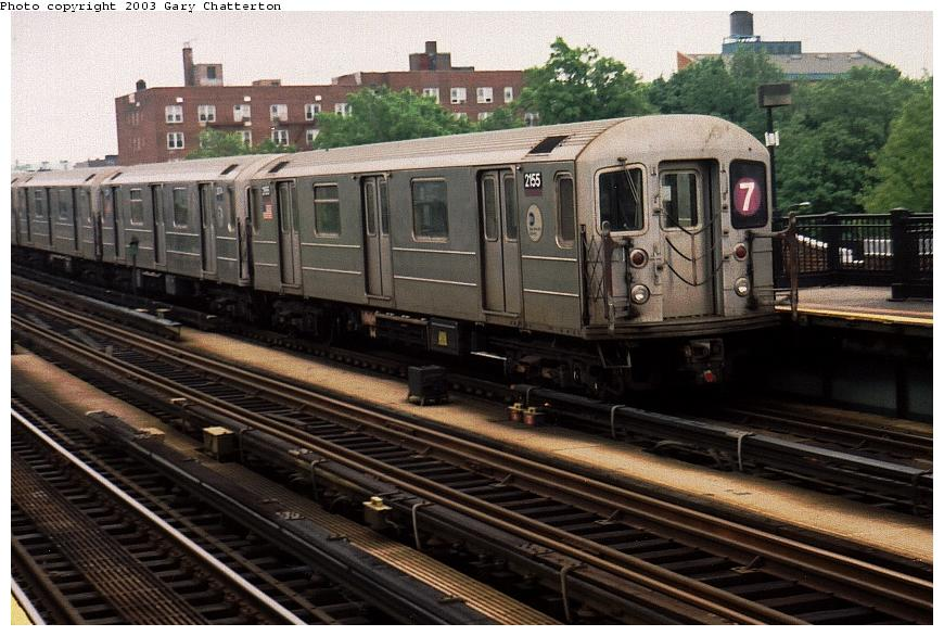 (93k, 870x586)<br><b>Country:</b> United States<br><b>City:</b> New York<br><b>System:</b> New York City Transit<br><b>Line:</b> IRT Flushing Line<br><b>Location:</b> 69th Street/Fisk Avenue <br><b>Route:</b> 7<br><b>Car:</b> R-62A (Bombardier, 1984-1987)  2155 <br><b>Photo by:</b> Gary Chatterton<br><b>Date:</b> 5/24/2003<br><b>Viewed (this week/total):</b> 5 / 2242