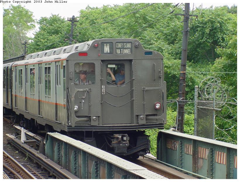 (117k, 820x620)<br><b>Country:</b> United States<br><b>City:</b> New York<br><b>System:</b> New York City Transit<br><b>Line:</b> BMT Myrtle Avenue Line<br><b>Location:</b> Metropolitan Avenue <br><b>Route:</b> Fan Trip<br><b>Car:</b> R-7A (Pullman, 1938)  1575 <br><b>Photo by:</b> John Miller<br><b>Date:</b> 6/28/2003<br><b>Viewed (this week/total):</b> 0 / 2977