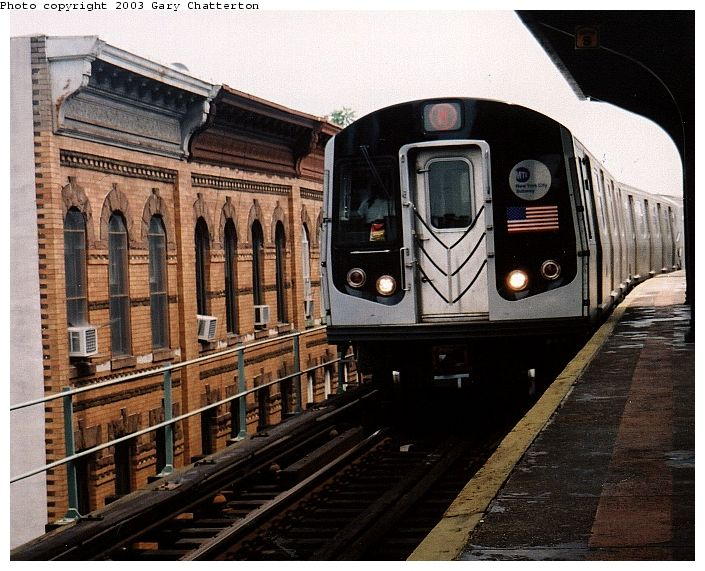 (92k, 705x571)<br><b>Country:</b> United States<br><b>City:</b> New York<br><b>System:</b> New York City Transit<br><b>Line:</b> BMT Myrtle Avenue Line<br><b>Location:</b> Seneca Avenue <br><b>Route:</b> M<br><b>Car:</b> R-143 (Kawasaki, 2001-2002) 8137 <br><b>Photo by:</b> Gary Chatterton<br><b>Date:</b> 6/28/2003<br><b>Viewed (this week/total):</b> 0 / 4733