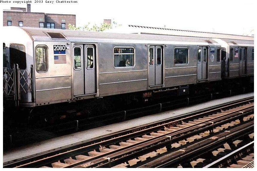 (110k, 860x571)<br><b>Country:</b> United States<br><b>City:</b> New York<br><b>System:</b> New York City Transit<br><b>Line:</b> IRT Flushing Line<br><b>Location:</b> 52nd Street/Lincoln Avenue <br><b>Route:</b> 7<br><b>Car:</b> R-62A (Bombardier, 1984-1987)  2080 <br><b>Photo by:</b> Gary Chatterton<br><b>Date:</b> 7/3/2003<br><b>Viewed (this week/total):</b> 0 / 2894