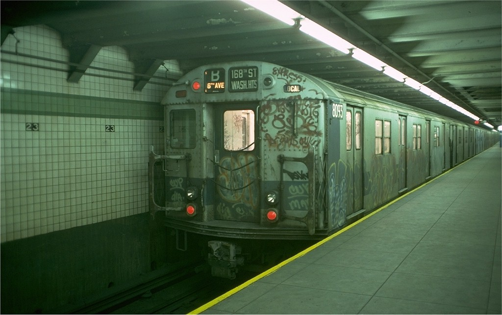 (148k, 1024x642)<br><b>Country:</b> United States<br><b>City:</b> New York<br><b>System:</b> New York City Transit<br><b>Line:</b> IND 6th Avenue Line<br><b>Location:</b> 23rd Street <br><b>Route:</b> B<br><b>Car:</b> R-27 (St. Louis, 1960)  8093 <br><b>Photo by:</b> Doug Grotjahn<br><b>Collection of:</b> Joe Testagrose<br><b>Date:</b> 12/14/1976<br><b>Viewed (this week/total):</b> 2 / 3736