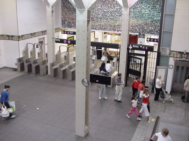 (61k, 640x480)<br><b>Country:</b> United States<br><b>City:</b> New York<br><b>System:</b> New York City Transit<br><b>Line:</b> IRT Flushing Line<br><b>Location:</b> Main Street/Flushing <br><b>Photo by:</b> Salaam Allah<br><b>Date:</b> 9/21/2002<br><b>Artwork:</b> <i>Happy World</i>, Ik-Joong Kang (1998).<br><b>Viewed (this week/total):</b> 8 / 7009