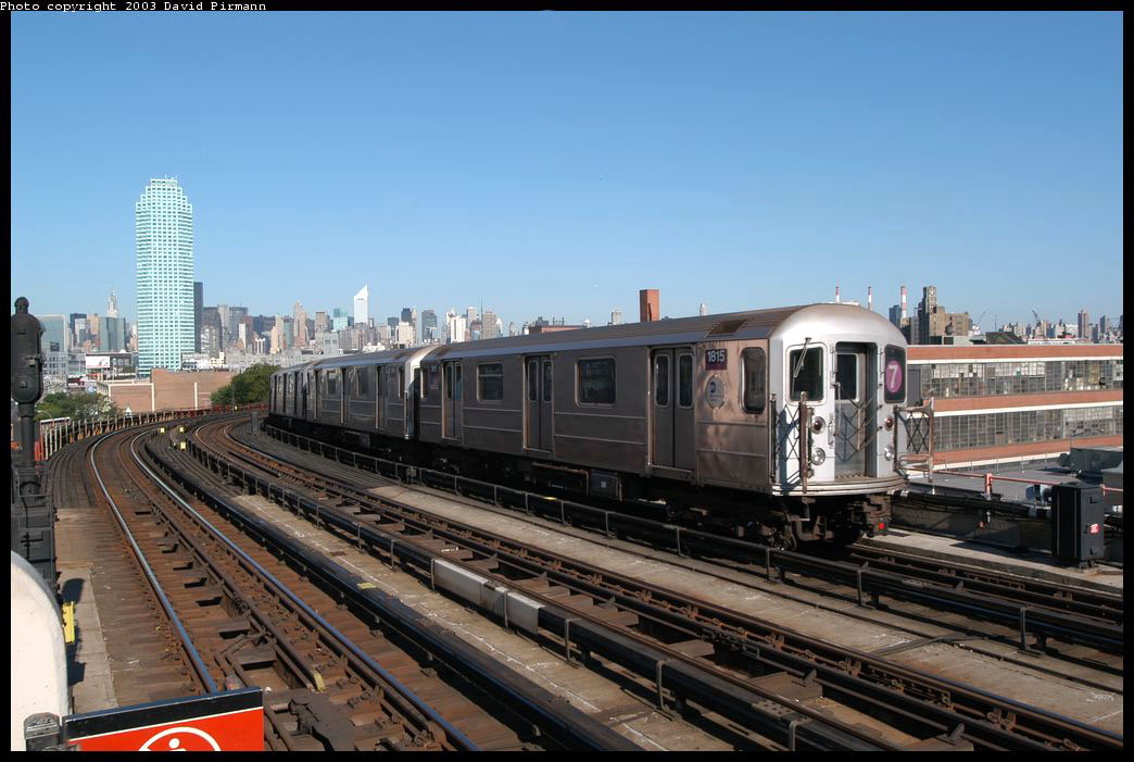 (207k, 1044x701)<br><b>Country:</b> United States<br><b>City:</b> New York<br><b>System:</b> New York City Transit<br><b>Line:</b> IRT Flushing Line<br><b>Location:</b> 33rd Street/Rawson Street <br><b>Route:</b> 7<br><b>Car:</b> R-62A (Bombardier, 1984-1987)  1815 <br><b>Photo by:</b> David Pirmann<br><b>Date:</b> 8/23/2003<br><b>Viewed (this week/total):</b> 2 / 3059