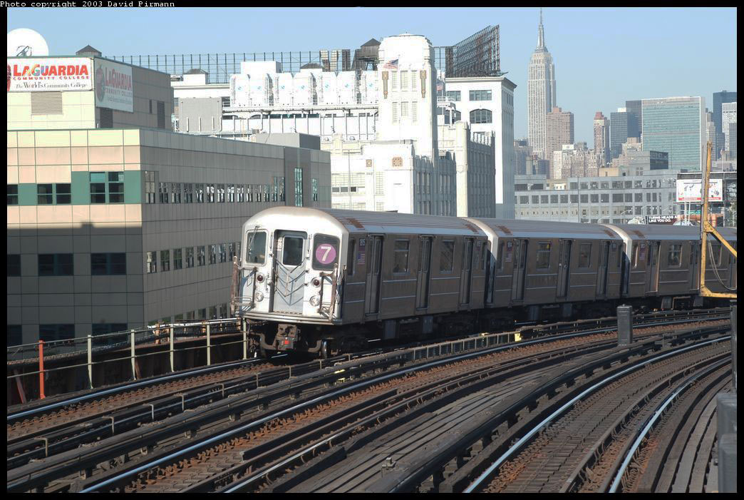 (234k, 1044x701)<br><b>Country:</b> United States<br><b>City:</b> New York<br><b>System:</b> New York City Transit<br><b>Line:</b> IRT Flushing Line<br><b>Location:</b> 33rd Street/Rawson Street <br><b>Route:</b> 7<br><b>Car:</b> R-62A (Bombardier, 1984-1987)  1815 <br><b>Photo by:</b> David Pirmann<br><b>Date:</b> 8/23/2003<br><b>Viewed (this week/total):</b> 0 / 2550