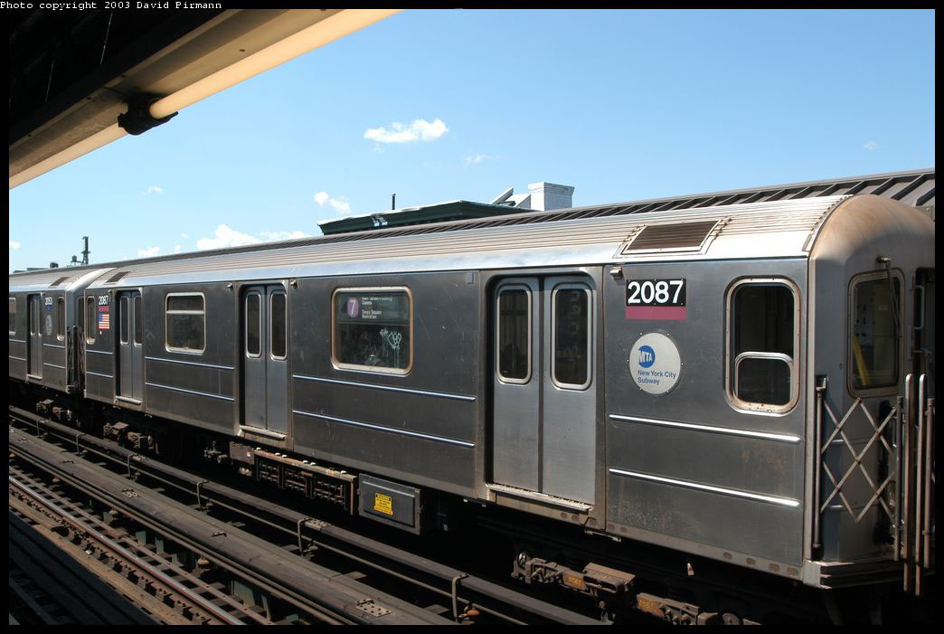 (195k, 1044x701)<br><b>Country:</b> United States<br><b>City:</b> New York<br><b>System:</b> New York City Transit<br><b>Line:</b> IRT Flushing Line<br><b>Location:</b> Court House Square/45th Road <br><b>Route:</b> 7<br><b>Car:</b> R-62A (Bombardier, 1984-1987)  2087 <br><b>Photo by:</b> David Pirmann<br><b>Date:</b> 8/23/2003<br><b>Viewed (this week/total):</b> 2 / 2054