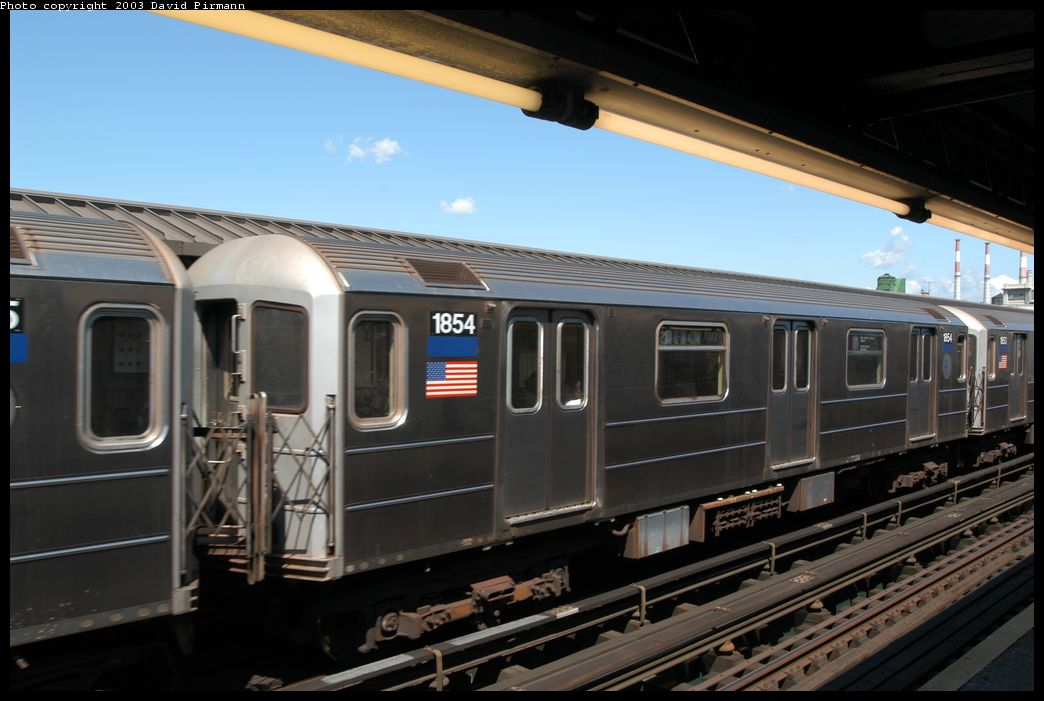 (154k, 1044x701)<br><b>Country:</b> United States<br><b>City:</b> New York<br><b>System:</b> New York City Transit<br><b>Line:</b> IRT Flushing Line<br><b>Location:</b> Court House Square/45th Road <br><b>Route:</b> 7<br><b>Car:</b> R-62A (Bombardier, 1984-1987)  1854 <br><b>Photo by:</b> David Pirmann<br><b>Date:</b> 8/23/2003<br><b>Viewed (this week/total):</b> 2 / 2457