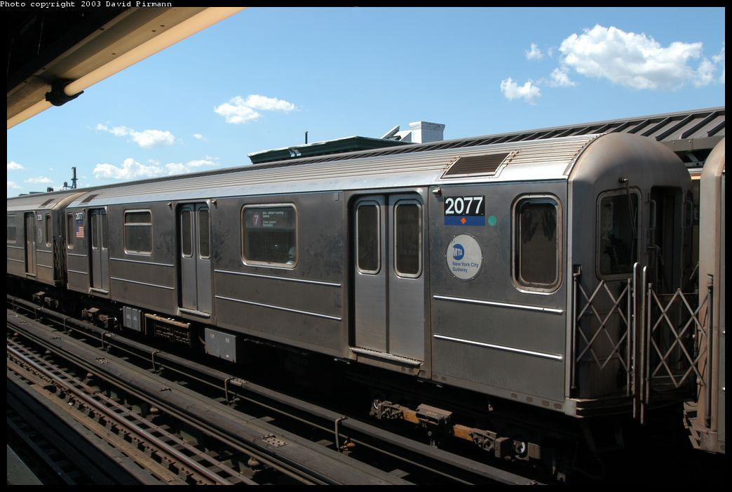 (191k, 1044x701)<br><b>Country:</b> United States<br><b>City:</b> New York<br><b>System:</b> New York City Transit<br><b>Line:</b> IRT Flushing Line<br><b>Location:</b> Court House Square/45th Road <br><b>Route:</b> 7<br><b>Car:</b> R-62A (Bombardier, 1984-1987)  2077 <br><b>Photo by:</b> David Pirmann<br><b>Date:</b> 8/23/2003<br><b>Viewed (this week/total):</b> 3 / 1944