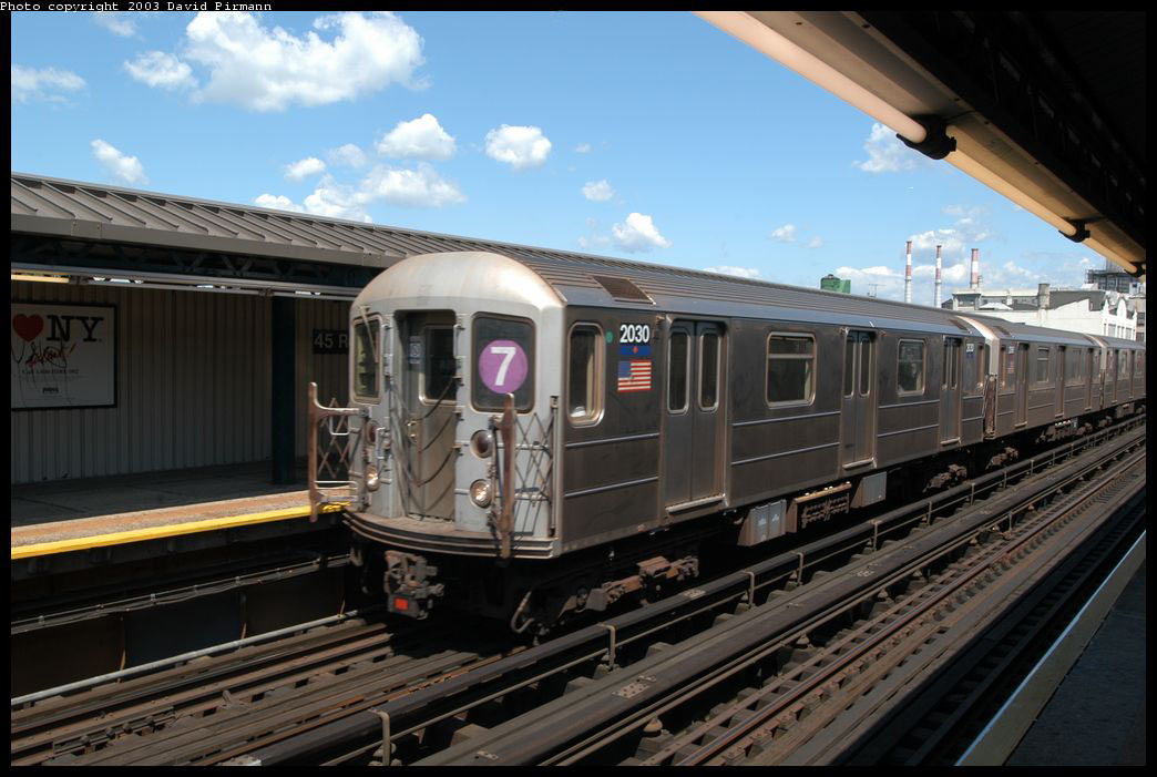 (190k, 1044x701)<br><b>Country:</b> United States<br><b>City:</b> New York<br><b>System:</b> New York City Transit<br><b>Line:</b> IRT Flushing Line<br><b>Location:</b> Court House Square/45th Road <br><b>Route:</b> 7<br><b>Car:</b> R-62A (Bombardier, 1984-1987)  2030 <br><b>Photo by:</b> David Pirmann<br><b>Date:</b> 8/23/2003<br><b>Viewed (this week/total):</b> 5 / 5175