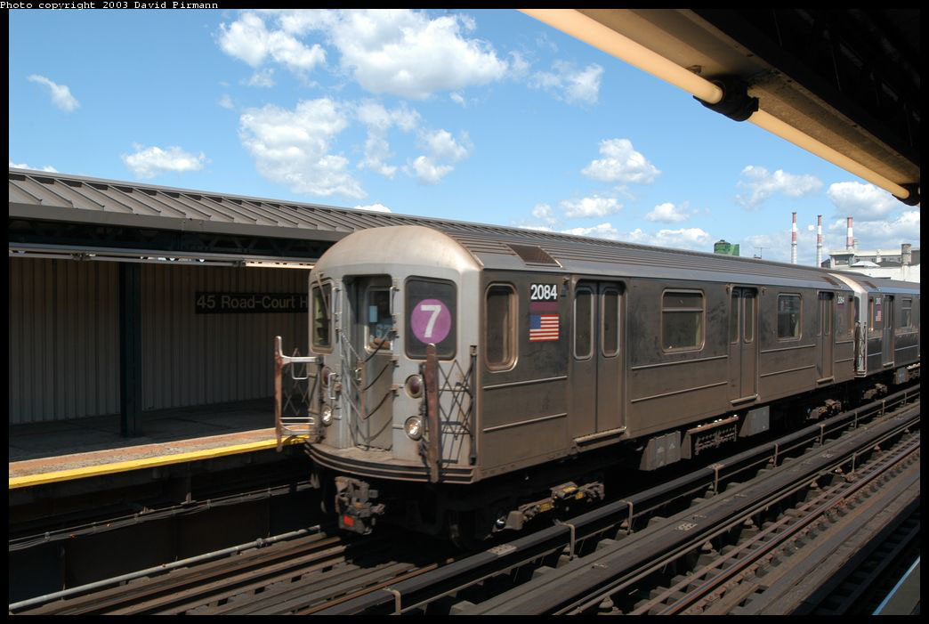 (197k, 1044x701)<br><b>Country:</b> United States<br><b>City:</b> New York<br><b>System:</b> New York City Transit<br><b>Line:</b> IRT Flushing Line<br><b>Location:</b> Court House Square/45th Road <br><b>Route:</b> 7<br><b>Car:</b> R-62A (Bombardier, 1984-1987)  2084 <br><b>Photo by:</b> David Pirmann<br><b>Date:</b> 8/23/2003<br><b>Viewed (this week/total):</b> 1 / 2469