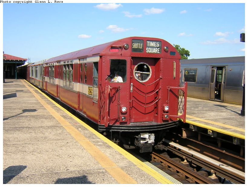 (133k, 820x620)<br><b>Country:</b> United States<br><b>City:</b> New York<br><b>System:</b> New York City Transit<br><b>Line:</b> BMT Astoria Line<br><b>Location:</b> Astoria Boulevard/Hoyt Avenue <br><b>Route:</b> Fan Trip<br><b>Car:</b> R-15 (American Car & Foundry, 1950) 6239 <br><b>Photo by:</b> Glenn L. Rowe<br><b>Date:</b> 8/23/2003<br><b>Viewed (this week/total):</b> 1 / 3627