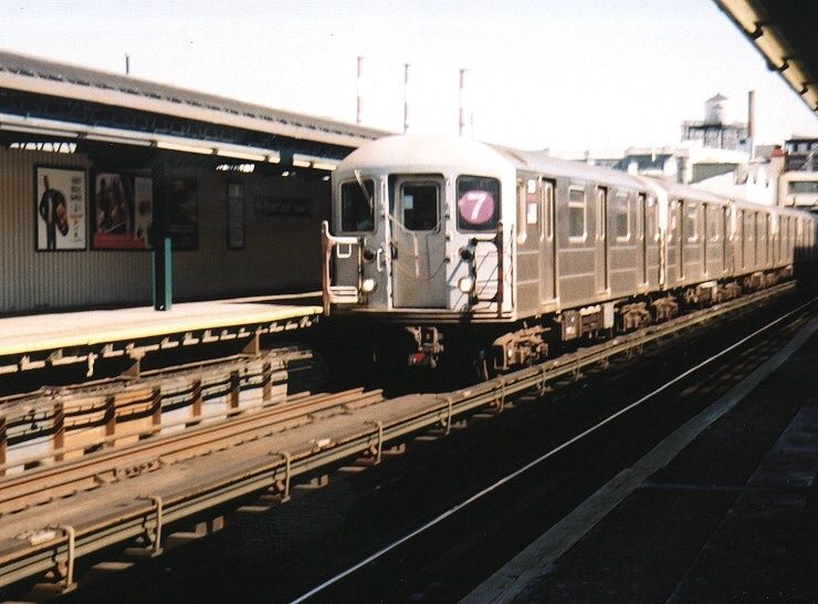 (74k, 740x546)<br><b>Country:</b> United States<br><b>City:</b> New York<br><b>System:</b> New York City Transit<br><b>Line:</b> IRT Flushing Line<br><b>Location:</b> Court House Square/45th Road <br><b>Route:</b> 7<br><b>Car:</b> R-62A (Bombardier, 1984-1987)  2128 <br><b>Photo by:</b> Gary Chatterton<br><b>Date:</b> 8/23/2003<br><b>Viewed (this week/total):</b> 3 / 2116