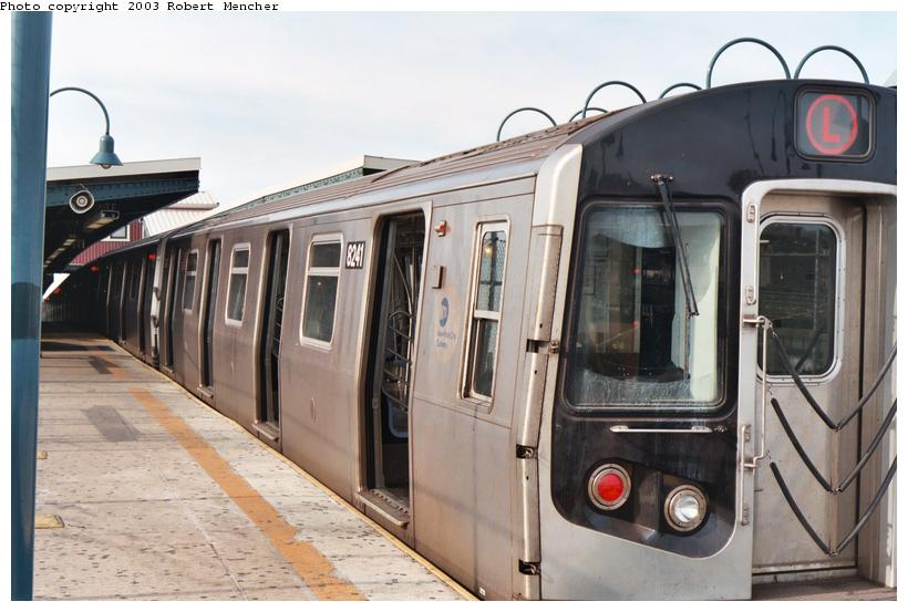(93k, 820x553)<br><b>Country:</b> United States<br><b>City:</b> New York<br><b>System:</b> New York City Transit<br><b>Line:</b> BMT Canarsie Line<br><b>Location:</b> Broadway Junction <br><b>Route:</b> L<br><b>Car:</b> R-143 (Kawasaki, 2001-2002) 8241 <br><b>Photo by:</b> Robert Mencher<br><b>Date:</b> 9/2003<br><b>Viewed (this week/total):</b> 1 / 3722