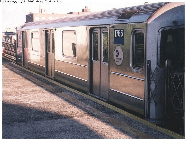(98k, 780x591)<br><b>Country:</b> United States<br><b>City:</b> New York<br><b>System:</b> New York City Transit<br><b>Line:</b> IRT Flushing Line<br><b>Location:</b> 69th Street/Fisk Avenue <br><b>Route:</b> 7<br><b>Car:</b> R-62A (Bombardier, 1984-1987)  1786 <br><b>Photo by:</b> Gary Chatterton<br><b>Date:</b> 10/2/2003<br><b>Viewed (this week/total):</b> 8 / 3121