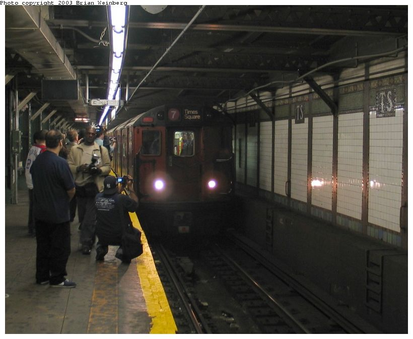 (80k, 820x673)<br><b>Country:</b> United States<br><b>City:</b> New York<br><b>System:</b> New York City Transit<br><b>Line:</b> IRT Flushing Line<br><b>Location:</b> Times Square <br><b>Car:</b> R-36 World's Fair (St. Louis, 1963-64) 9564 <br><b>Photo by:</b> Brian Weinberg<br><b>Date:</b> 11/3/2003<br><b>Notes:</b> View of train on last revenue Redbird service entering Times Square.<br><b>Viewed (this week/total):</b> 0 / 5021