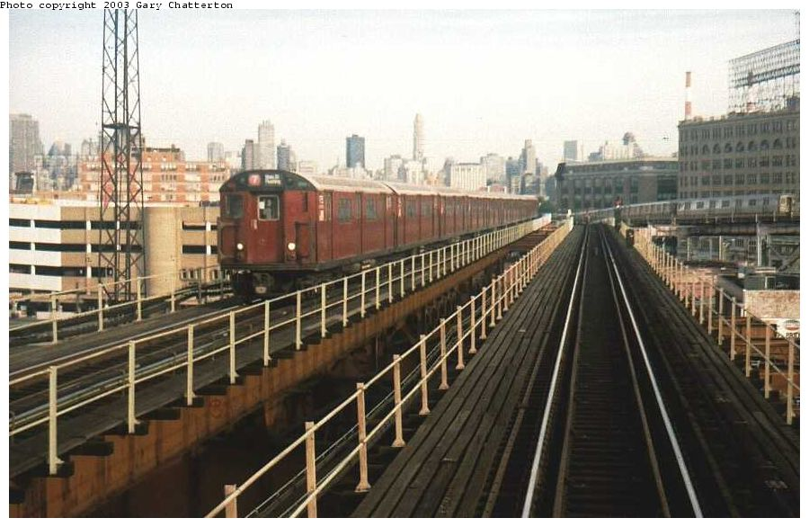(95k, 900x586)<br><b>Country:</b> United States<br><b>City:</b> New York<br><b>System:</b> New York City Transit<br><b>Line:</b> IRT Flushing Line<br><b>Location:</b> Queensborough Plaza <br><b>Route:</b> 7<br><b>Car:</b> R-36 World's Fair (St. Louis, 1963-64) 9755 <br><b>Photo by:</b> Gary Chatterton<br><b>Date:</b> 8/2002<br><b>Viewed (this week/total):</b> 2 / 3765