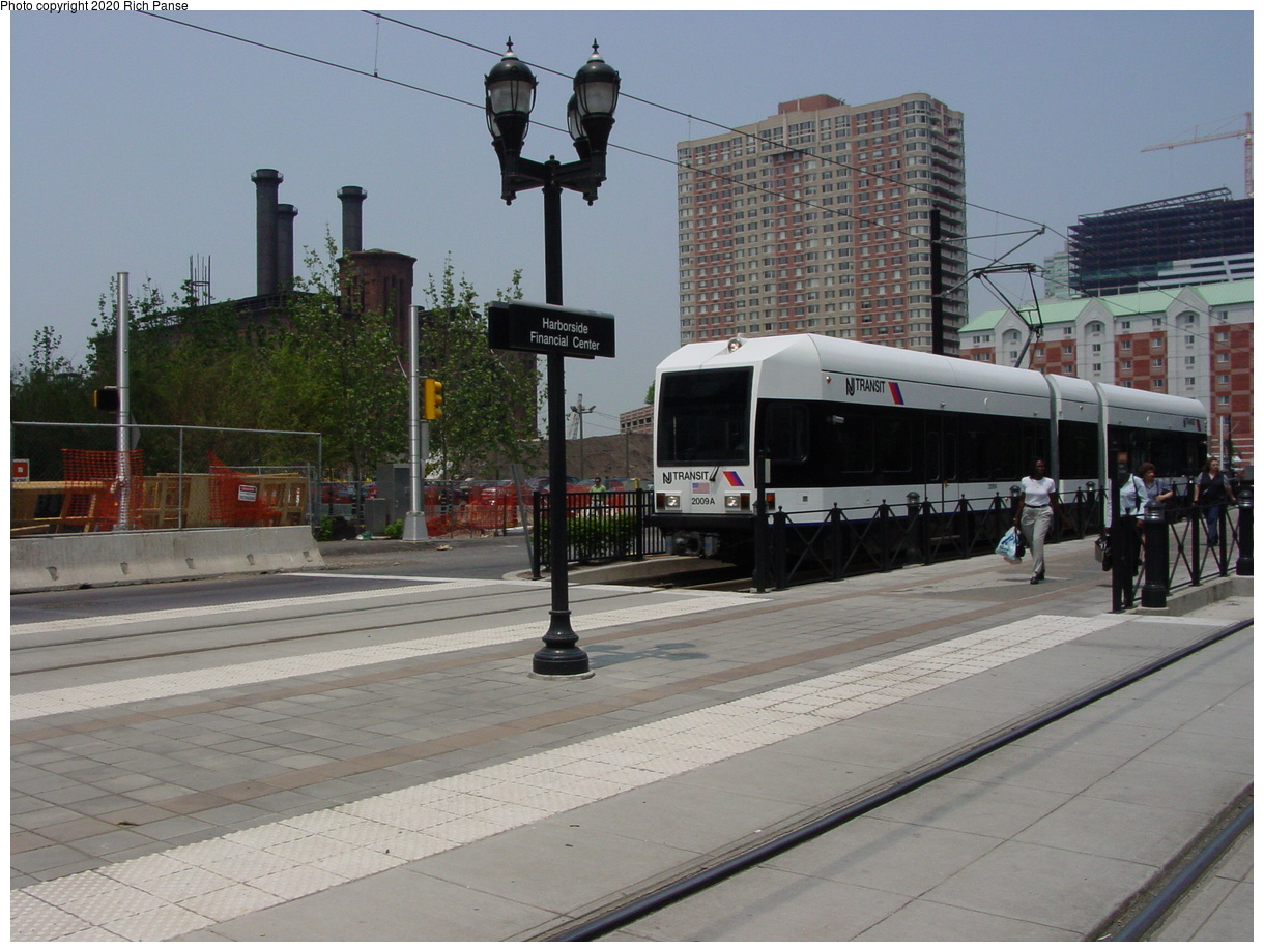 (76k, 820x620)<br><b>Country:</b> United States<br><b>City:</b> Jersey City, NJ<br><b>System:</b> Hudson Bergen Light Rail<br><b>Location:</b> Harborside <br><b>Car:</b> NJT-HBLR LRV (Kinki-Sharyo, 1998-99)  2008 <br><b>Photo by:</b> Richard Panse<br><b>Date:</b> 6/5/2002<br><b>Viewed (this week/total):</b> 0 / 2764