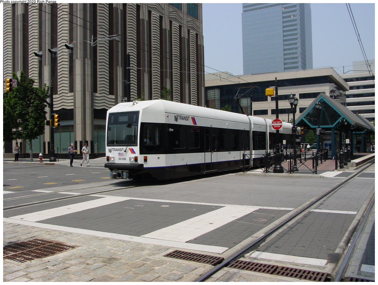 (95k, 820x620)<br><b>Country:</b> United States<br><b>City:</b> Jersey City, NJ<br><b>System:</b> Hudson Bergen Light Rail<br><b>Location:</b> Exchange Place <br><b>Car:</b> NJT-HBLR LRV (Kinki-Sharyo, 1998-99)  2015 <br><b>Photo by:</b> Richard Panse<br><b>Date:</b> 6/5/2002<br><b>Viewed (this week/total):</b> 0 / 3219