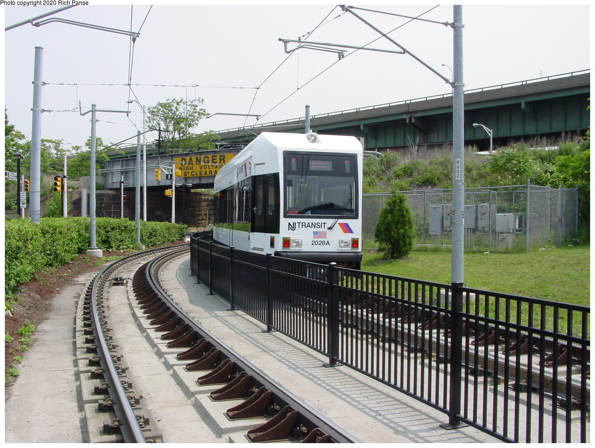 (103k, 820x620)<br><b>Country:</b> United States<br><b>City:</b> Jersey City, NJ<br><b>System:</b> Hudson Bergen Light Rail<br><b>Location:</b> Liberty State Park <br><b>Car:</b> NJT-HBLR LRV (Kinki-Sharyo, 1998-99)  2028 <br><b>Photo by:</b> Richard Panse<br><b>Date:</b> 6/5/2002<br><b>Viewed (this week/total):</b> 4 / 3008