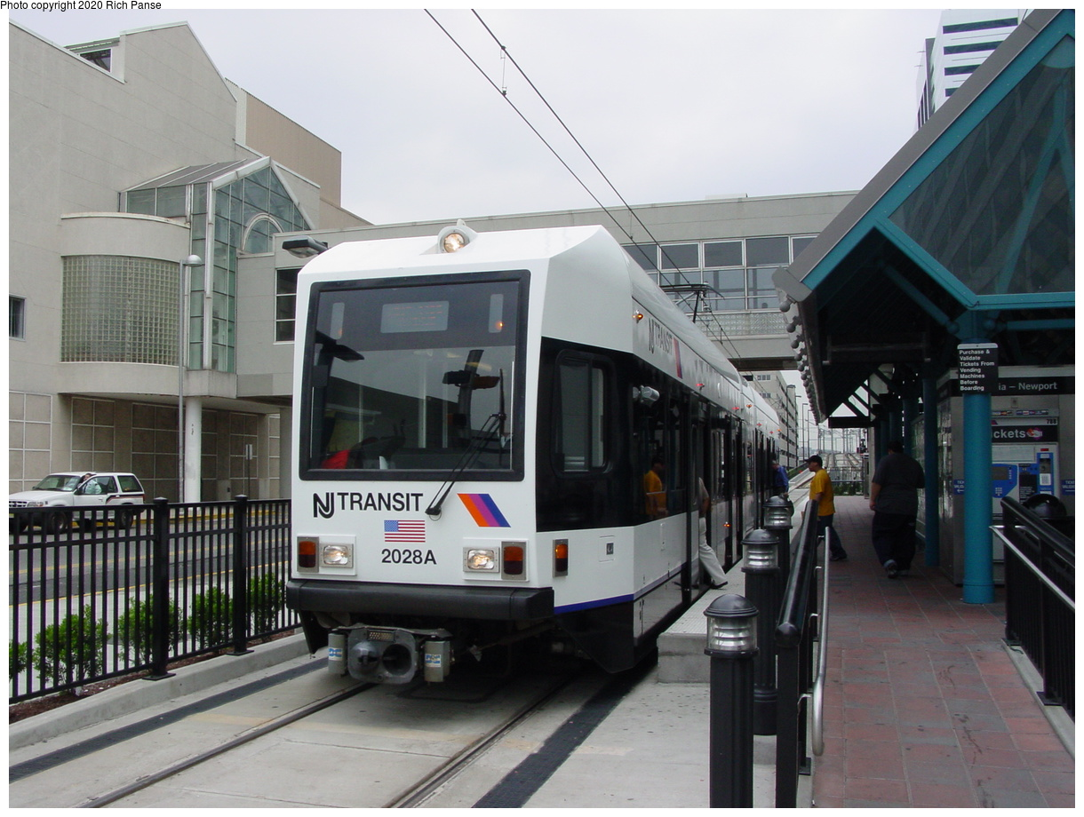 (76k, 820x620)<br><b>Country:</b> United States<br><b>City:</b> Jersey City, NJ<br><b>System:</b> Hudson Bergen Light Rail<br><b>Location:</b> Pavonia/Newport <br><b>Car:</b> NJT-HBLR LRV (Kinki-Sharyo, 1998-99)  2028 <br><b>Photo by:</b> Richard Panse<br><b>Date:</b> 6/5/2002<br><b>Viewed (this week/total):</b> 2 / 3567