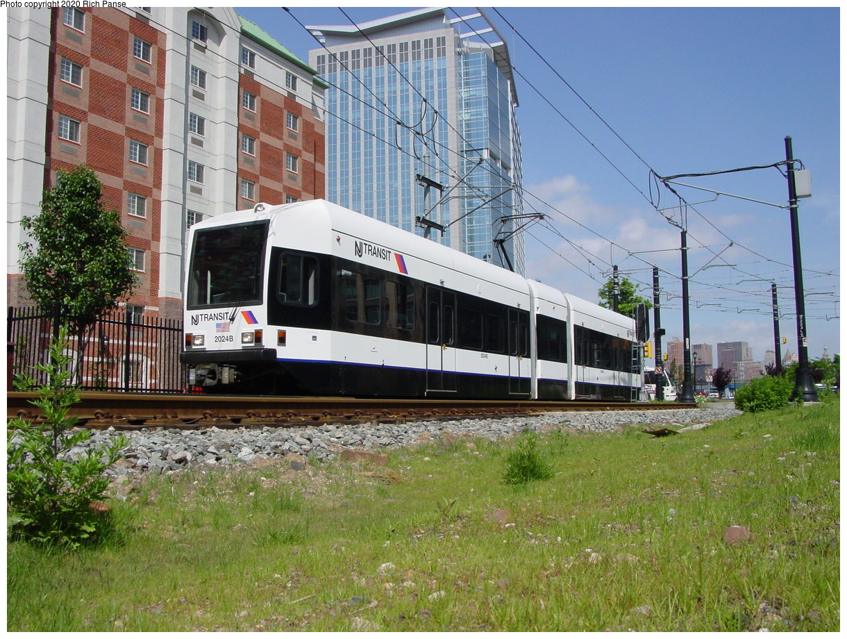 (93k, 768x576)<br><b>Country:</b> United States<br><b>City:</b> Jersey City, NJ<br><b>System:</b> Hudson Bergen Light Rail<br><b>Location:</b> Harborside <br><b>Car:</b> NJT-HBLR LRV (Kinki-Sharyo, 1998-99)  2024 <br><b>Photo by:</b> Richard Panse<br><b>Date:</b> 2003<br><b>Notes:</b> North of Harborside near Washington Blvd. grade crossing<br><b>Viewed (this week/total):</b> 0 / 2619
