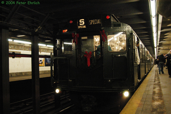 (137k, 720x478)<br><b>Country:</b> United States<br><b>City:</b> New York<br><b>System:</b> New York City Transit<br><b>Line:</b> BMT Canarsie Line<br><b>Location:</b> 1st Avenue <br><b>Route:</b> Fan Trip<br><b>Car:</b> R-1 (American Car & Foundry, 1930-1931) 100 <br><b>Photo by:</b> Peter Ehrlich<br><b>Date:</b> 12/28/2003<br><b>Viewed (this week/total):</b> 3 / 3453