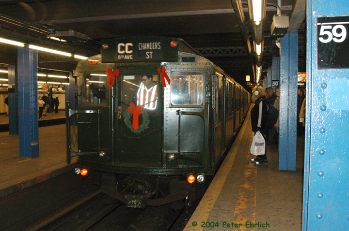 (170k, 720x478)<br><b>Country:</b> United States<br><b>City:</b> New York<br><b>System:</b> New York City Transit<br><b>Line:</b> IND 8th Avenue Line<br><b>Location:</b> 59th Street/Columbus Circle <br><b>Route:</b> Fan Trip<br><b>Car:</b> R-1 (American Car & Foundry, 1930-1931) 100 <br><b>Photo by:</b> Peter Ehrlich<br><b>Date:</b> 12/28/2003<br><b>Viewed (this week/total):</b> 0 / 3440